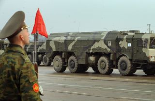 A Russian missile launcher rolls through Moscow's outskirts while rehearsing for a parade.