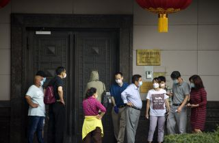 A group of people stand outside the Chinese consulate in Houston, Texas, after the United States ordered Beijing to immediately close the office on July 22, 2020.