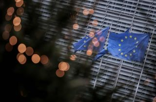 EU flags fly outside the European Commission building in Brussels on Dec. 7, 2020.