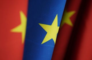Chinese and EU flags stand at the chancellery on Jan. 26, 2021, in Berlin, Germany. The two entities recently reached a comprehensive agreement on investment.