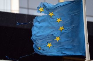 A shredded EU flag flutters in the wind on March 1, 2016, in Brussels, Belgium.