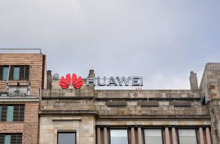 A Huawei logo looms over a street in Barcelona, Spain.