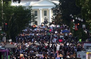 Demonstrators protest police brutality and racism on June 6, 2020, in Washington.