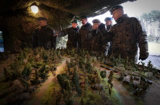 A three star general visits an exhibit at a military base in Bydgoszcz, Poland on March 9, 2019.