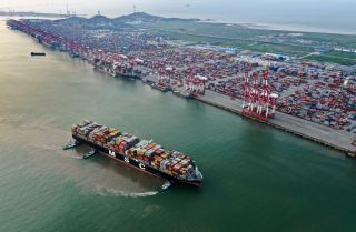 An aerial view of a container vessel at Shanghai's Yangshan Deep-Water Port on Aug. 13, 2019