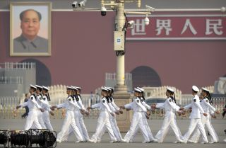 Cadets from China's People's Liberation Army (PLA) Navy march in formation before a ceremony at Tiananmen Square in Beijing on Sept. 30, 2019.