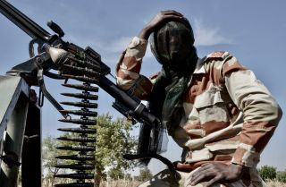 A soldier keeps guard near the Nigerian border in Maradi, Niger.