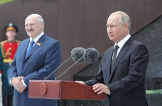 Russian President Vladimir Putin (right) and Belarusian President Alexander Lukashenko (left) take part in a ceremony in Rzhev, Russia, on June 30, 2020.