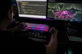 A member of the hacking group Red Hacker uses a website that monitors global cyberattacks in Dongguan, China, on Aug. 4, 2020.
