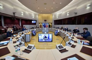 Negotiators attend the third meeting of the EU-U.K. Joint Committee under the Withdrawal Agreement in Brussels, Belgium, on Sept. 28, 2020, with the EU chief Brexit negotiator Michel Barnier (center) dialing in on video.