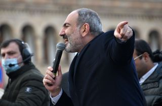 Armenian Prime Minister Nikol Pashinyan addresses his supporters gathered on Republic Square in downtown Yerevan, Armenia, on Feb. 25, 2021. Pashinyan called on the army to fulfill its duty and obey the people after the military called for him to resign.