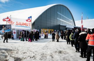 Voters stand in line to cast their ballots in the parliamentary election in Greenland's capital of Nuuk on April 6, 2021.