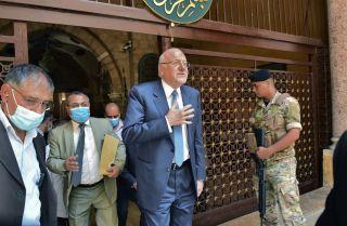 Lebanese Prime Minister-designate Najib Mikati leaves a mosque in Beirut on Sept. 10, 2021.
