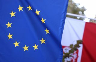 The EU and Polish flags are seen at the entrance of the Polish Permanent Representation to the European Union on Oct. 8, 2021, in Brussels, Belgium.