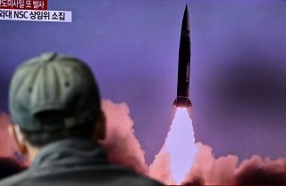 A man watches a television showing file footage of a North Korean missile test on Oct. 19, 2021, in Seoul, South Korea.