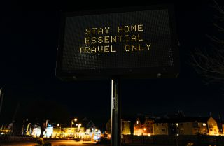 A sign advises people to follow COVID-19 restrictions on Jan. 5, 2021, in Falmouth, the United Kingdom. In a televised address on Jan. 4, U.K. Prime Minister Boris Johnson announced the country was entering its third lockdown since the onset of the pandemic in early 2020.