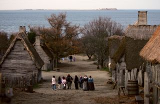 """People visit the 1627 Pilgrim Village at """"Plimoth Plantation,"""" where role-players portray pilgrims seven years after the arrival of the Mayflower, in November 2005."""