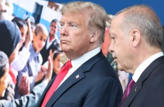 U.S. President Donald Trump (left) talks with his Turkish counterpart, Recep Tayyip Erdogan, on the sidelines of the NATO summit in Brussels, Belgium, on July 11, 2018.