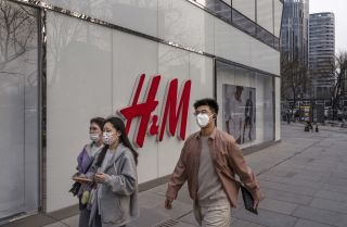People walk past an H&M store in Beijing, China, on March 25, 2021.