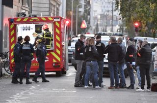 Emergency personnel on Oct. 31, 2020, in Lyon, France, at the scene of an attack on a Greek Orthodox priest.