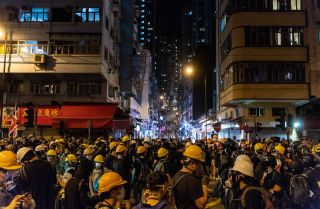 Protesters clash with police after taking part in an anti-extradition bill on July 22, 2019, in Hong Kong.