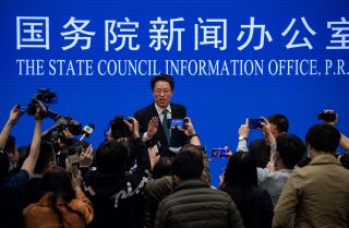 Zhang Xiaoming (C), Executive Deputy Director of the Hong Kong and Macao Affairs Office of the State Council, at the end of a State Council press conference on Hong Kong electoral reform March 12, 2021, in Beijing.
