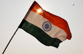 India's national flag waves above a rally in New Delhi.
