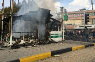 This photo shows a smoldering police station in Isfahan, Iran, the result of violent protests against fuel price increases.