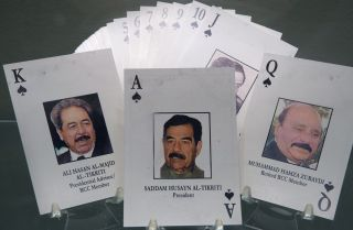"""A deck of the """"52 most-wanted Iraqi"""" playing cards from Operation Iraqi Freedom on display in October 2014 at the Pentagon showing high-level members of the Baath Party."""