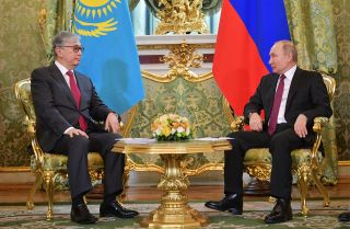 Kazakhstan's acting President Kassym-Jomart Tokayev sits next to Russian President Vladimir Putin during a meeting at the Kremlin.