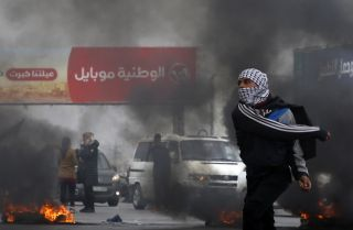 Palestinian protesters clash with Israeli security forces south of the West Bank city of Nablus on Dec. 29, 2017.