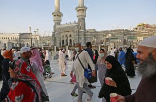 Muslim pilgrims wear masks at the Grand Mosque in Saudi Arabia's holy city of Mecca on Feb. 28, 2020.
