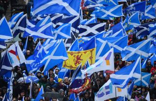 Protesters with Scottish Saltire flags attend a march calling for Scottish independence in Glasgow on Jan. 11, 2020.