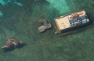 An aerial photograph taken by the Philippine Air Force in November 2003 shows Chinese-built structures near the disputed Spratly Islands in the South China Sea.