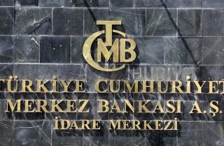 A picture taken on Aug. 14, 2018, shows the logo of Turkey's central bank at the entrance of its headquarters in Ankara.