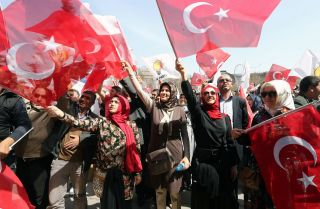 Supporters cheer for Ankara Mayor Melih Gokcek, a member of Turkey's ruling Justice and Development Party, on April 5, 2014.