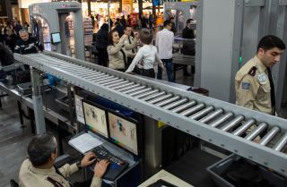 Airport security checks passengers in the Ataturk airport in Turkey.