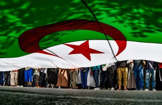 Protesters bearing an Algerian flag march in Algiers on May 31, 2019.