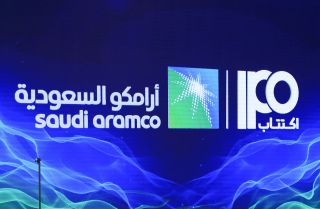 This photo shows a sign for Saudi Aramco's initial public offering during a news conference in Dhahran, Saudi Arabia, on Nov. 3, 2019.