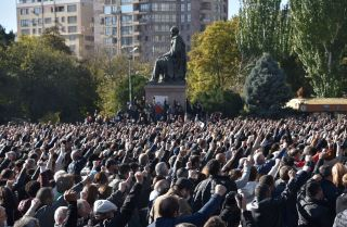 Armenians gather in Yerevan on Nov. 11, 2020, to protest against their country's agreement to end fighting with Azerbaijan over the disputed Nagorno-Karabakh region.