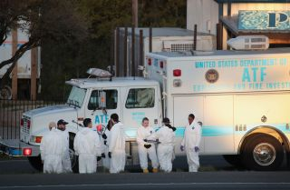 A picture shows evidence technicians in Round Rock, Texas, searching for evidence at the site where serial bomber Mark Anthony Conditt ended his life with a self-inflicted bomb blast.