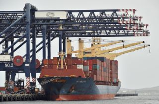 Workers load containers on a cargo ship at Port Botany in Sydney, Australia, on Dec. 2, 2020.