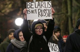 People gather for a rally against Belarus' closer integration with Russia in Minsk's Oktyabrskaya Square on Dec. 20, 2019.