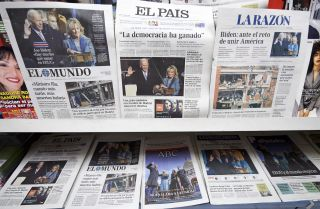 Spanish newspapers show images of newly sworn-in U.S. President Joe Biden on Jan. 21, 2021, in Madrid, Spain.