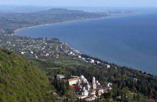 A photograph shows Abkhazia's Black Sea coast.