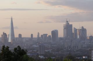 The skyline in London is all aglow as the sun sets on Aug. 16, 2018.