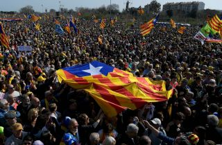 Demonstrators hold a Catalonian flag ahead of a political meeting in Perpignan, France, on Feb. 29, 2020.