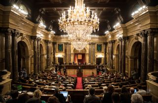 Quim Torra, a strong advocate for Catalan succession, delivers remarks to the regional parliament during his investiture as the region's president on May 14.