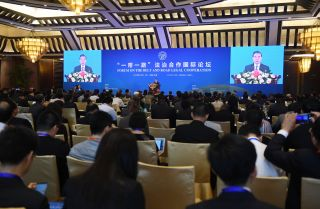 Chinese Foreign Minister Wang Yi speaks during the opening session of the Belt and Road Forum on Legal Cooperation at the Diaoyutai State Guesthouse in Beijing on July 2, 2018.