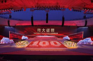 Actors perform in celebration of the 100th anniversary of the founding of the Communist Party of China on June 28, 2021, in Beijing.